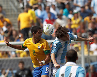 Brazil midfielder Romulo (8) and Argentina forward  Lionel Messi (10) battle for head ball. In an international friendly (Clash of Titans), Argentina defeated Brazil, 4-3, at MetLife Stadium on June 9, 2012.