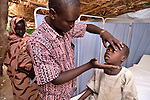 In the Ardabba displaced persons camp near Garsila, in Sudan's war-torn Darfur region, ACT/Caritas provides primary health care -- including the services of Dr. Robert Lobor -- to displaced families as well as members of the local host community. ..