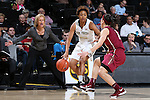 28 January 2016: Wake Forest's Ariel Stephenson (25) and Florida State's Brittany Brown (right). The Wake Forest University Demon Deacons hosted the Florida State University Seminoles at Lawrence Joel Veterans Memorial Coliseum in Winston-Salem, North Carolina in a 2015-16 NCAA Division I Women's Basketball game. Florida State won the game 96-55.
