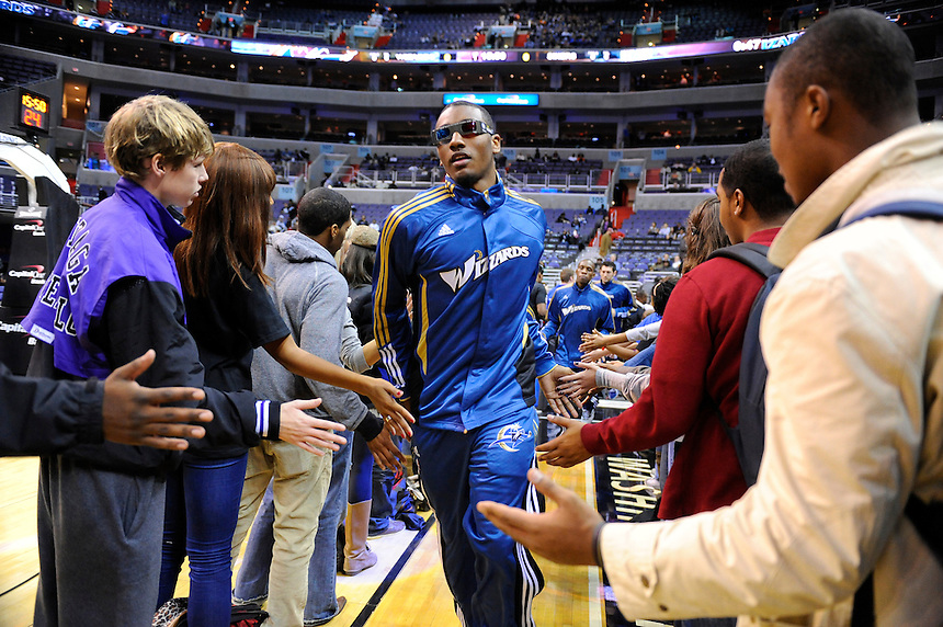 Future so bright he has to wear shades. John Wall greet Wizard fans prior to tip-off against the Philadelphia 76ers during the home season opener at the Verizon Center in Washington, DC on Tuesday, November 2, 2010. Alan P. Santos/DC Sports Box