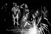 India. Province of Gujarat. Alang. Workers cut metal during a shift at night. Alang, located in the Gulf of Khambhat, is a ships breaking place and is considered as the biggest scrapyard in the world. Ships recycling for its metals. Environmental issues. Hazardous waste. © 1992 Didier Ruef