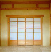 Although traditional adobe methods have been used in the construction of this house in New Mexico there is a disticntly Japanese feel to this sliding door