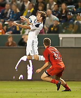 CARSON, CA – June 3, 2011: LA Galaxy midfielder Mike Magee (18) receives a ball and shields out DC United defender Chris Korb (22) during the match between LA Galaxy and DC United at the Home Depot Center in Carson, California. Final score LA Galaxy 0, DC United 0.