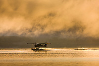 Float plane lands on Naknek lake on a foggy morning, Katmai National Park, Alaska.