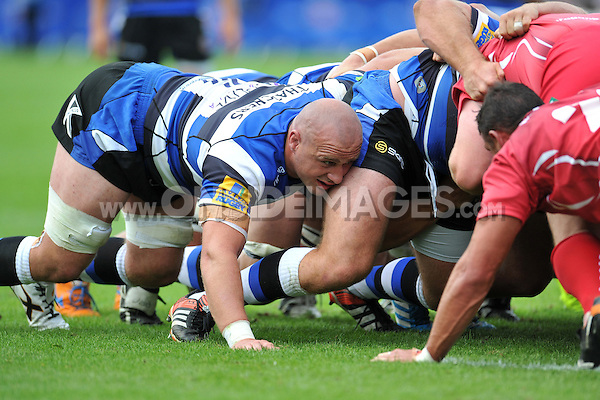 Carl Fearns in action at a scrum. Pre-season friendly match, between Bath Rugby and the Scarlets on August 16, 2014 at the Recreation Ground in Bath, England. Photo by: Patrick Khachfe / Onside Images