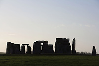 Silhouettes at twilight, Stonehenge, Neolithic and Bronze Age megalithic monument, 3050 - 1500 BC, Salisbury, Wiltshire, England, UK. Picture by Manuel Cohen