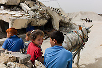 Al Tufa'ah, June 3, 2010.18 months after the 'Cast Lead' israeli military operation, people are trying to recycle cement and iron from the rubble to rebuild thousands of destroyed buildings, as the israeli blockade still prevent much needed external supplies to reach the strip.