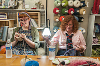 STAFF PHOTO ANTHONY REYES &bull; @NWATONYR<br /> ALL NAMES CQUED<br /> B'ney Landis, left, of Gentry, and Lois Allen, of Bella Vista, crochet and knit Thursday, Sept. 18, 2014 during a crocheting and knitting class at Mockingbird Moon in Rogers. Landis is making the second in a pair of slippers and Allen is working on a cowl.
