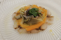 The appetizer of Umbrine millefeuille with artichokes and baby carrots at Pappagallo, Bologna. The Pappagallo Restaurant in Bologna was established in 1919. It continues to serve traditional Bolognese cuisine. Photo Sydney Low