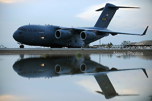 Joint Base Balad, Iraq - October 31, 2008 -- A C-17 Globemaster III taxis after landing on Friday, October 31, 2008 at Joint Base Balad, Iraq. The aircraft is reflected in a pool of water created due to recent flooding at the base.  The C-17 is deployed from McGuire Air Force Base, New Jersey .Credit: Jason Epley - U.S. Air Force via CNP