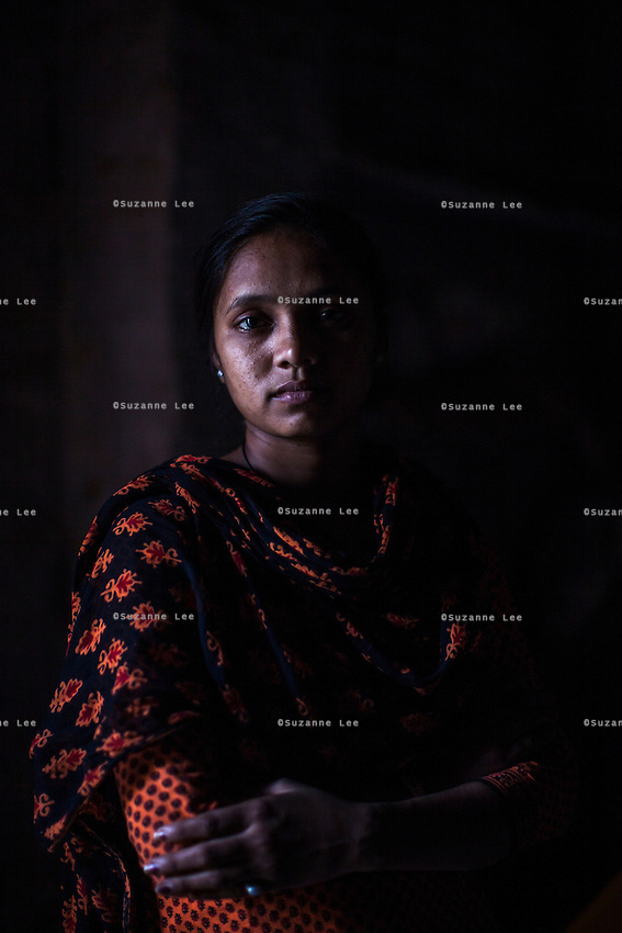 Saroj, a rescued girl under Guria's witness protection program while fighting her case in court, poses for a portrait while in hiding with her mother and father in a safe house in Uttar Pradesh, India on 16 November 2013.