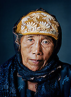 "Niyem (born 1933) was one of tens of thousands of 'comfort women' forced into prostitution by the Japanese military during World War II..As a 10-year-old child, Niyem was kidnapped while playing and taken in a truck full of women to a military tent camp in West Java. Once there, the prettiest women were locked up as live-ins by officers in their residences. Niyem had to share a small tent with two other girls, where soldiers raped them in the presence of others. She didn't get much to eat and had to drink water from a ditch. ""I was still so young, within two months my body was completely destroyed. It's sufficient that I have had to go through it, my grandchildren should be spared this kind of thing. I was nothing but a toy, as a human being I meant nothing, that's how it felt during the Japanese era."" After two months, Niyem managed to escape with a small group when the guards weren't paying attention. After she returned home, her parents didn't recognize her because she had become very thin and hadn't been able to wash her hair for months. ""I didn't dare tell anyone that I had been raped, I didn't want to hurt my parents. I was afraid that no one would want me, that I would be left out. But people still abused me by calling me a 'Japanese hand-me-down'. Because I had been gone so long, they suspected what had happened. It hurt me tremendously."" She managed to get married only at an older age, to an old widower. But she is very grateful that as an old spinster, she found a husband and had five children: ""Without children, you have no history.""."