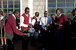 ELDORET, KENYA - MAY 19: Jonathan Kitum, age 16, (Left) and Eliud Kibet, age 18, (Far Right) have tea at Kipkeino Highschool early in the morning as the sun goes up. They are promising long distance runners and they have already trained for an hour from 5.15 in the morning. (Photo by:  Per-Anders Pettersson)