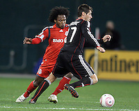 Branko Boskovic #27 of D.C. United pushes the ball away from Julian de Guzman #6 of Toronto FC during an MLS match that was the final appearance of D.C. United's Jaime Moreno at RFK Stadium, in Washington D.C. on October 23, 2010. Toronto won 3-2.