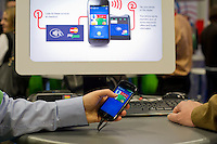 00091686 New York, New York.  1/16/2012 NATIONAL RETAIL FEDERATION TRADE SHOW.  Google demonstrates Google Wallet at the annual National Retail Federation trade show at the Jacob Javits Convention Center in New York    FRANCES ROBERTS/FREELANCE PHOTOGRAPHER
