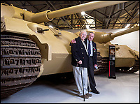 BNPS.co.uk (01202 558833)<br /> Pic: PhilYeomans/BNPS<br /> <br /> Ernest Slarks (right) and Wilhelm Fischer.<br /> <br /> This is the poignant moment two German Tiger tank drivers and their British counterparts met for the first time 72 years after they fought on opposite sides in the Second World War.<br /> <br /> Wilhelm Fischer and Waldemar Pliska helped instill terror in British troops by manning the fearsome fighting machines and unleashing hell with their huge 88mm guns.<br /> <br /> Two of the enemy with first hand experiences of the heavily armoured Tigers were British tank men Ernest Slarks and Dr Ken Tout.<br /> <br /> Now aged in their 90s the four old foes became friends when they assembled for the launch of an historic exhibition at the Tank Museum in Bovington, Dorset.