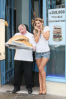 NO REPRO FEE. 3/2/2011.Vogue opens the Counter.  Fade Street star Vogue Williams tucks into a 20lb giant hamburger at the opening of the Counter restaurant in Suffolk St. Dublin with Ken Brown, director of operations who in the past has personally cooked for such hollywood star as Tom Hanks, Arnold Schwarzenegger and Mike Myres. Picture James Horan/Collins Photos