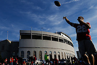 David Eder, of Marysville, plays catch with some friends as they tailgate before the NCAA football game between the Ohio State Buckeyes and the Wisconsin Badgers at Ohio Stadium in Columbus, Saturday evening, September 28, 2013.  Eder says he tries to make a few homes games every year. (Columbus Dispatch  / Eamon Queeney)
