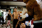 """""""KK,"""" right, advises Sovann """"Fresh"""" Dyrithy, 18, dance teacher, center, on moves during a class session at Tiny Toones Youth Center, in Phnom Penh, Cambodia, on Wednesday, April 21, 2010. The center, which opened in 2004 by a Long Beach, Ca deportee, """"KK"""", provides mentoring and educational classes, along with hip-hop music writing and breakdancing classes, for at-risk youth."""