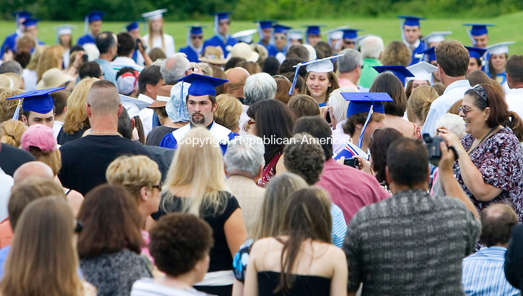 WASHINGTON, CT- 21 JUNE 2008- 062108JT07-<br /> Shepaug graduates weave through the crowd as they walk to their seats at the beginning of graduation ceremonies at the school on Saturday.<br /> Josalee Thrift / Republican-American
