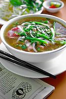 Enjoying a bowl of pho, or Vietnamese rice noodle soup, at A Saigon Cafe in Wailuku, Maui