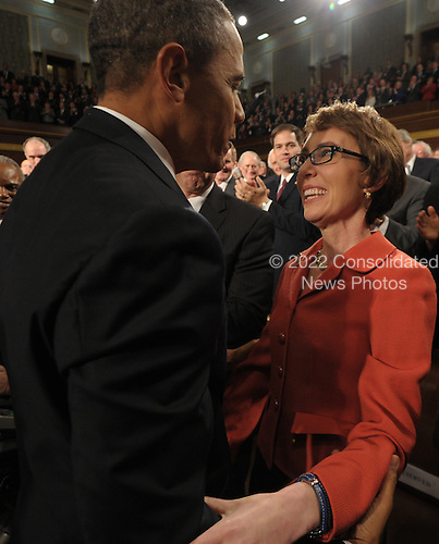 United States President Barack Obama greets U.S. Representative Gabrielle Giffords (Democrat of Arizona) as members of Congress applaud before his his State of the Union address in fornt of a joint session of Congress on Tuesday, January 24, 2012 on Capitol Hill in Washington, DC. .Credit: Saul Loeb / Pool via CNP