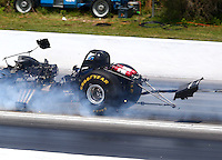 May 18, 2014; Commerce, GA, USA; NHRA funny car driver Tommy Johnson Jr explodes the carbon fiber body off his car during the Southern Nationals at Atlanta Dragway. Johnson was uninjured in the explosion. Mandatory Credit: Mark J. Rebilas-USA TODAY Sports