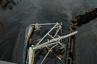 A shrimp boat is capsized by Hurricane Katrina and its fuel leaks into the water.