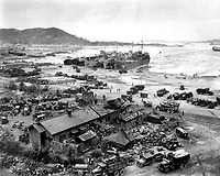 Invasion of Ichon, Korea.  Four LST's unload men and equipment on beach.  Three of the LST's shown are LST-611, LST-745, and LST-715.  September 15, 1950.  C.K. Rose. (Navy)<br /> NARA FILE #:  080-G-420027<br /> WAR &amp; CONFLICT BOOK #:  1406