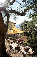 Sun dappled terraced gardens at 'I Cerri', 14th century Watch-tower of Poreta Castle, Spoleto, Umbria, Italy