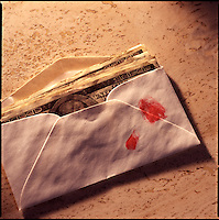 Envelope of money with bloody thumbprint on marble background