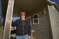 NWA Democrat-Gazette/BEN GOFF @NWABENGOFF<br /> Sharon Whelchel poses for a photo on the porch of the 'tiny house' Friday, April 7, 2017, which will serve as a guest house on her property in Garfield. Whelchel has founded Arkansas Veterans Village, a nonprofit which is trying to build a housing project with small houses of approximately 400 square feet for homeless and struggling military veterans in Northwest Arkansas.