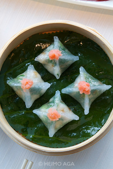 China, Hong Kong S.A.R..The Ritz-Carlton, Hong Kong. World's highest Dim Sum at Tin Lung Heen..Shrimp and vegetable dumplings with spicy cod roe.
