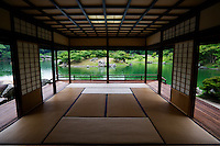 The sukiya design of the Kikugetsu-tei tea house at Ritsurin Park looks out onto the landscaped garden.