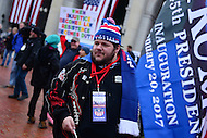 Washington, DC - January 20, 2017: Nicholas Phillips sells Trump souvenir merchandise as protestors gather in front of Union Station in the district of Columbia before the inauguration of Donald J. Trump as the 45th President of the United States, January 20, 2017.  (Photo by Don Baxter/Media Images International)