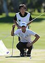 (T-B) Hiroyuki Kato, Ryo Ishikawa (JPN),.JANUARY 18, 2013 - Golf :.Ryo Ishikawa of Japan lines up a putt with his caddie Hiroyuki Kato during the second round of the Humana Challenge at the Arnold Palmer Private Course at PGA West in La Quinta, California, United States. (Photo by AFLO)