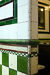 Original Victorian tiling in Manze's Eel, Pie and Mash shop on Tower Bridge Road London, UK.This pie shop was opened in 1897 and is the oldest pie and eel shop in the countryEel, pie and mash shops are a traditional but dying business. Changing tastes and the scarcity of the eel has meant that the number of shops selling this traditional working class food has declined to just a handful mostly in east London. The shops were originally owned by one or two families with the earliest recorded, Manze's on Tower Bridge Road being the oldest surviving dating from 1908. Generally eels are sold cold and jellied and the meat pie and mash potato covered in a green sauce called liquor.