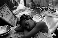 Leogane, Haiti, Jan 22, 2010.Oseline Desilmé, 10, next to the rubble of her former home..