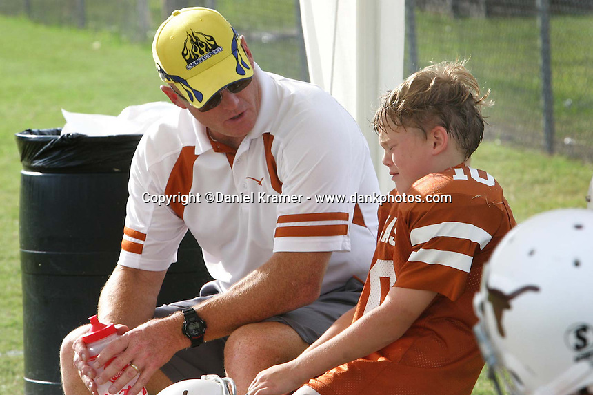 Longhorn coach Skip Cummins talks to his son, Max, after chewing him out for a foul. This story was originally published November 9, 2006 in the Houston Press. In 2007, the Houston Press Club awarded it First Place in the Photo Package category and Second Place in the Sports Writing category.
