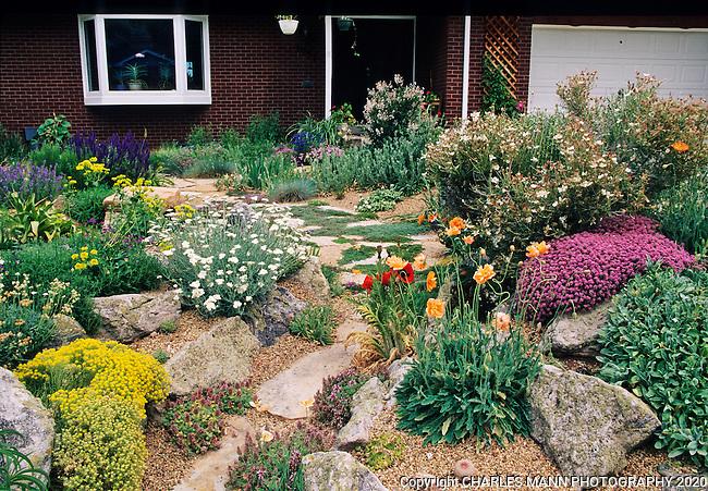A beautiful Xeriscape garden by John Smithin Golde, Colorado, features poppies, apache plume, sedum, acantholimon and other drought tolerant plants.