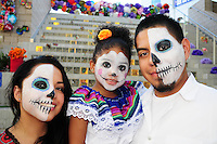 "Mesa, Arizona. October 28, 2012 - The Day of the Dead is a religious holiday celebrated in Mexico with a solemn mood to remember dead loved ones. However, in the Southwest of the United States and in states like Arizona, the holiday takes a form of a cultural festivity, the turning the traditional ""Día de los Muertos"" into a festival-like event. Edgard Medrano, his wife and daughter attended the Dead Celebration at the Mesa Arts Center. They observed the religious celebration by having their faces painted, a feature of celebrations in the U.S., But not in Mexico's traditional observance. Photo Eduardo Barraza © 2012"