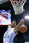 07 November 2014: North Carolina's J.P. Tokoto dunks the ball. The University of North Carolina Tar Heels played the Belmont Abbey College Crusaders in an NCAA Division I Men's basketball exhibition game at the Dean E. Smith Center in Chapel Hill, North Carolina.
