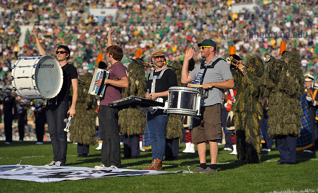"The band Ok Go performs ""This Too Shall Pass"" with the Notre Dame Marching band during halftime of the Pittsburgh game, Oct. 9, 2010."