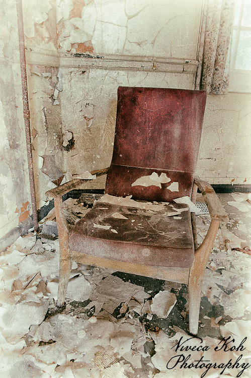 Single armchair in derelict West Park Asylum, Epsom, Surrey, processed to emulate wet plate technique.