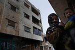 SYRIA, HOMS, Baba Amro: A Syrian woman is seen outside her house in Baba Amro, southern neighborhood of Homs, as Al Assad Army is shelling that area on February 06, 2012.  ALESSIO ROMENZI
