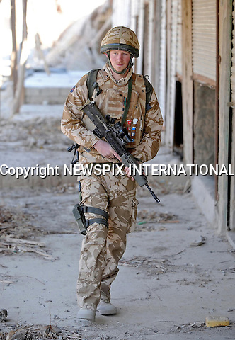 """Prince Harry on patrol through the deserted town of Garmisir close to FOB Delhi (forward operating base), where he was posted in Helmand province Southern Afghanistan..Photo Credit: NEWSPIX INTERNATIONAL..* NO UK USE UNTIL 18/03/2008 *.**ALL FEES PAYABLE TO: """"NEWSPIX INTERNATIONAL""""**..PHOTO CREDIT MANDATORY!!: NEWSPIX INTERNATIONAL(Failure to credit will incur a surcharge of 100% of reproduction fees)..IMMEDIATE CONFIRMATION OF USAGE REQUIRED:.Newspix International, 31 Chinnery Hill, Bishop's Stortford, ENGLAND CM23 3PS.Tel:+441279 324672  ; Fax: +441279656877.Mobile:  0777568 1153.e-mail: info@newspixinternational.co.uk"""