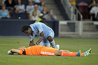 Kei Kamara (23) forward Sporting KC checks on an injured Matt Reis..Sporting Kansas City and New England Revolution played to a 0-0 tie at LIVESTRONG Sporting Park, Kansas City, KS.