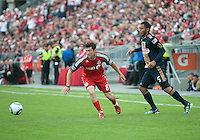 Toronto FC defender Dan Gargan #8 and Philadelphia Union defender Carlos Valdes #5 in action during an MLS game between the Philadelphia Union and the Toronto FC at BMO Field in Toronto on May 28, 2011..The Philadelphia Union won 6-2..
