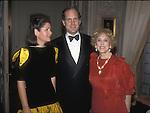 Ronald S. Lauder, tehn U.S. Ambassador to Austria, stands between his wife, Jo Carole, left, and his mother, Estée Lauder (Josephine Esther Mentzer) in Lauder's Georgetown home in 1986.