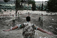 "Syria, Atmeh. Free Syria Army recruits are trained at ""unit 309 training camp"", on September 20, 2012. ALESSIO ROMENZI"